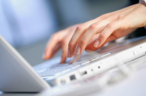 Hands of Businesswoman Using Laptop